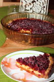 Piece of cake with cranberries. On a shortcake dough Stock Images