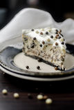 Piece of cake with cream and chocolate balls stock image