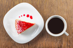 A piece of cake and a cup of black coffee Stock Image