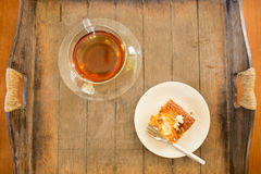 Piece of cake with cup of tea Stock Photography
