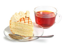 Piece of cake and cup of tea. On white Royalty Free Stock Images