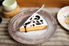 A piece of cake with dark honey. On textile napkin Stock Photography