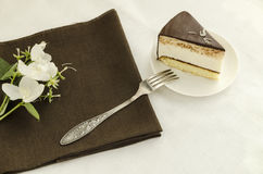 Piece of cake, decorated with jasmine flower Royalty Free Stock Images