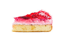 Piece of cake with delicate souffle, covered with strawberry jel. Piece of cake with delicate souffle and strawberries, covered with strawberry jelly and coconut Royalty Free Stock Images
