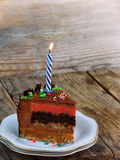 Piece of cake `Fairy Tale` and a candle Royalty Free Stock Photography