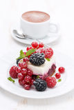 Piece of cake with fresh berries and coffee Royalty Free Stock Image