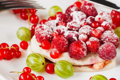 Piece of cake with fresh berries on white plate Royalty Free Stock Photo
