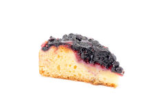 A piece of cake with fresh blueberries on a white background Stock Image