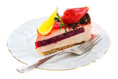 Piece of cake with a fresh strawberry and orange. Royalty Free Stock Photo