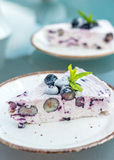 A piece of cake - frozen blueberry cheese cake on vintage English plates, on garden table Stock Photography