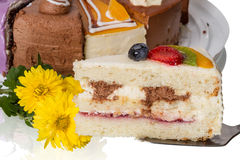 Piece of cake with fruit and  flowers Stock Images