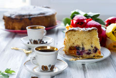 Piece of cake with fruit and two cups of coffee Royalty Free Stock Photos