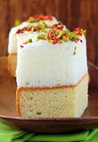 Piece of cake with marshmallows and pistachios Stock Photo