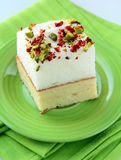 Piece of cake with marshmallows and pistachios Stock Image