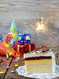 A piece of cake `Napoleon` with a sparkler. Birthday. Side view. Copy space. Stock Photography