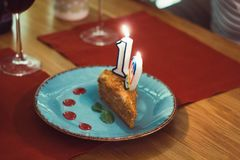 Piece of cake with the number nineteen in honor of the birthday celebration. In the restaurant royalty free stock photo