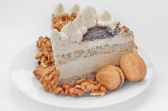 Piece of cake with nuts and cream Stock Photography