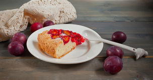 Piece of cake with organic plums Stock Photography