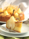 Piece of cake with pears with spun sugar strands. Stock Photos