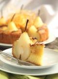 Piece of cake with pears with spun sugar strands. Selective focu Stock Photos