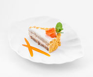 Piece of cake on plate with rose and mint leafs royalty free stock photo