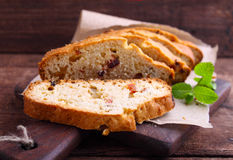 Piece of cake with raisins and candied fruit Stock Photography