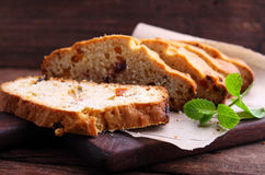 Piece of cake with raisins and candied fruit Royalty Free Stock Photography