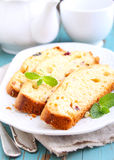 Piece of cake with raisins and candied fruit Stock Photo