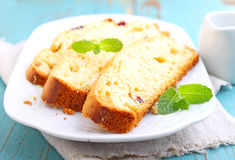 Piece of cake with raisins and candied fruit Royalty Free Stock Image