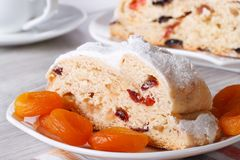 A piece of cake with raisins, dried apricots and candied Royalty Free Stock Images