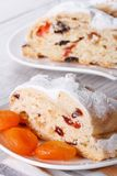 A piece of cake with raisins, dried apricots closeup. vertical Stock Photography