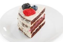 piece of cake with raspberries blueberries stock photos