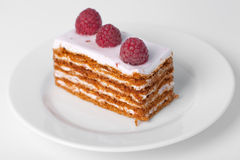 Piece of cake with a raspberry. On top Stock Photo