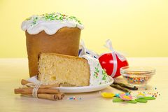 Piece of an cake on saucer and eggs Royalty Free Stock Image