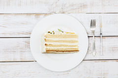 Piece of cake served on plate cutlery and insulin syringe next to it Royalty Free Stock Photos