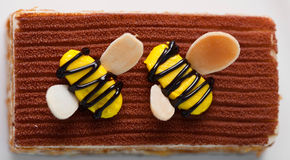 Piece of cake. With small bees on top Stock Image
