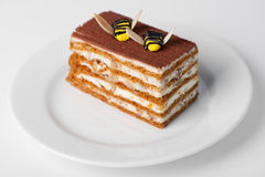 Piece of cake. With small bees on top Royalty Free Stock Image