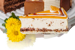 Piece of cake soufflé and yellow flowers Royalty Free Stock Photo