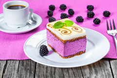 Piece of cake souffle with blackberries, cup of coffee, closeup Stock Photography