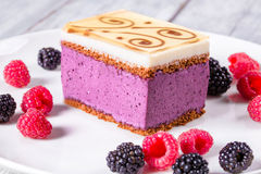 A piece of cake souffle with blackberries, raspberries, closeup Stock Image