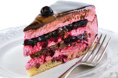 Piece of cake with souffle and jelly berries close up. Stock Photo