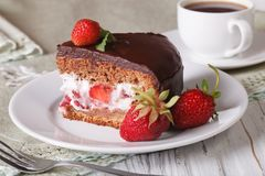 Piece of cake with strawberries and chocolate Royalty Free Stock Photos
