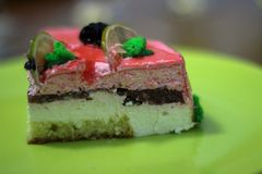 The piece of cake with strawberries and lime royalty free stock photos