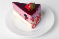 Piece of cake with a strawberry. On top Royalty Free Stock Image