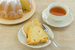 Piece of cake with tea. Piece of cake on a plate with tea Royalty Free Stock Images