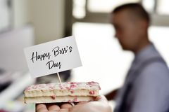Piece of cake with the text happy boss day Stock Photography