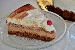 a piece of cake of three different layers on a small plate royalty free stock images