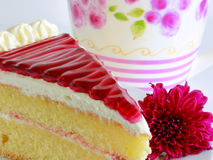 A PIECE OF CAKE and violet flower Stock Image