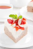 Piece of cake with whipped cream and strawberries close-up Stock Photos