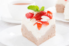 Piece of cake with whipped cream and strawberries Stock Photography